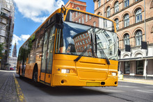 Yellow City Bus On Historic Street Of Copenhagen