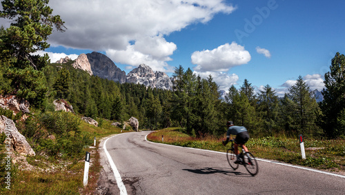 Wall mural - Mountain road. beautiful asphalt road in the evening. Incredible summer day. Vintage toning. Highway in mountains. Pass Giau. Dolomites Alps. Italy. popular travel and hiking destination