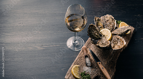 Fresh oysters with lemon ice and white wine. Wallpaper Mural