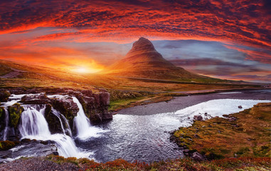 Scenic image of Iceland. Incredible Nature scenery during sunset. Great view on famous Mount Kirkjufell with Colorful, dramatic sky. popular plase for photografers. Best famous travel locations