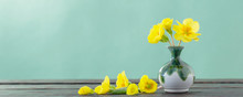 Yellow Primroses In Vase On Wo...