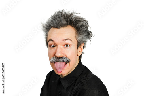 Photographie Portrait of jocular aging man with grey long hair sticking his tongue out in Einstein manner