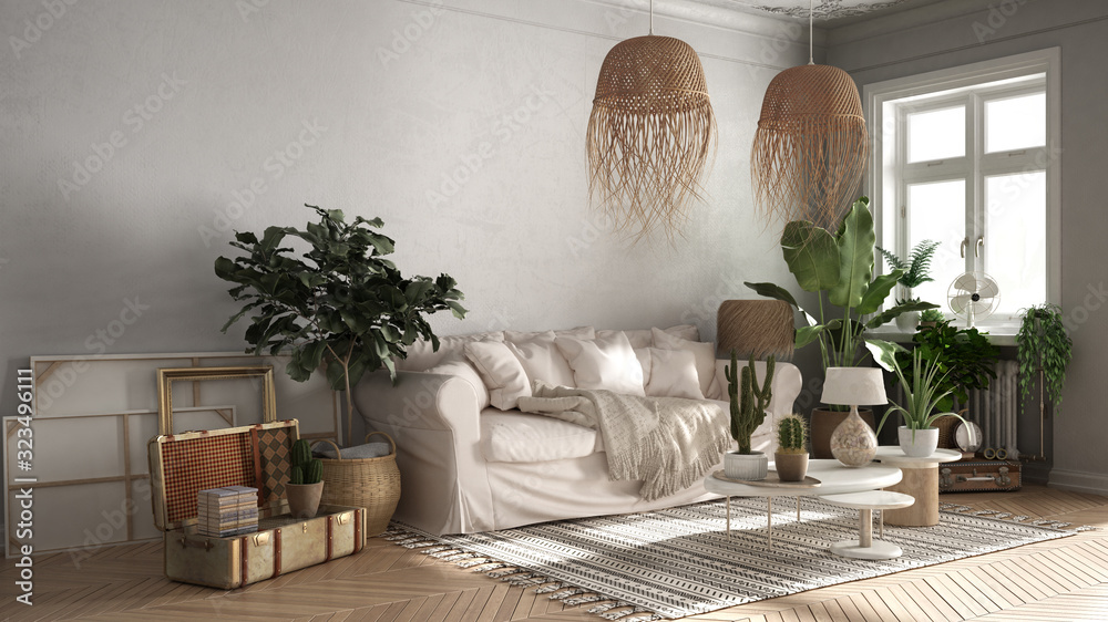 Fototapeta Vintage, old style living room in beige tones, Sofa, carpet, pillows and rattan pendant lamps, tables with decors and potted plants, carpet, window, retro interior design concept