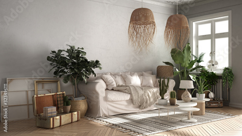 Obraz Vintage, old style living room in beige tones, Sofa, carpet, pillows and rattan pendant lamps, tables with decors and potted plants, carpet, window, retro interior design concept - fototapety do salonu