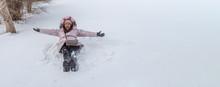 Traveller Woman Lying On Snow ...