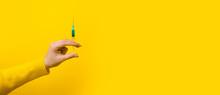 Hand Holding Syringe With Medi...