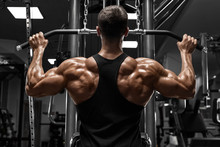 Muscular Man Workout In Gym, D...