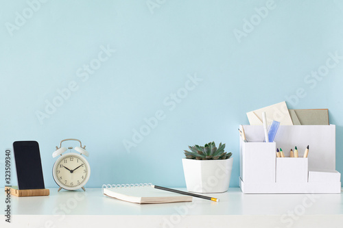 Modern mockup with office desk on white background.