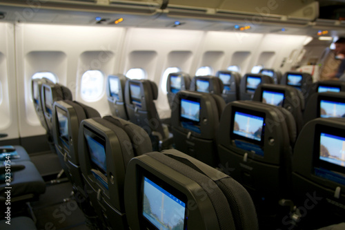 Photo COPENHAGEN, DENMARK - NOV 24th, 2018: Empty airplane seats waiting for passengers and take off in an airplane