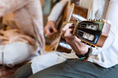 Fotografía Selective focus of woman hand playing classical guitar having nylon strings with