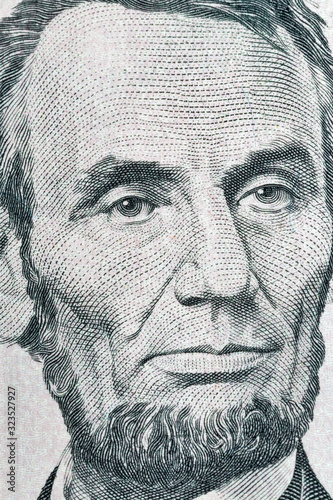 Photo Portrait of US president Lincoln from five dollars bill macro