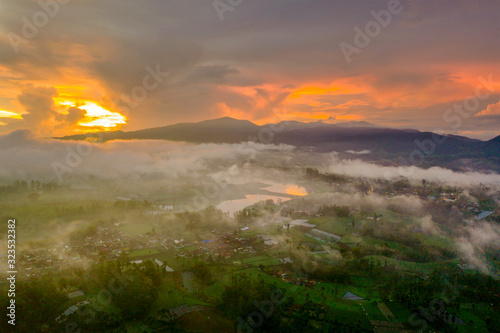 Aerial view of village with fog on sunrise