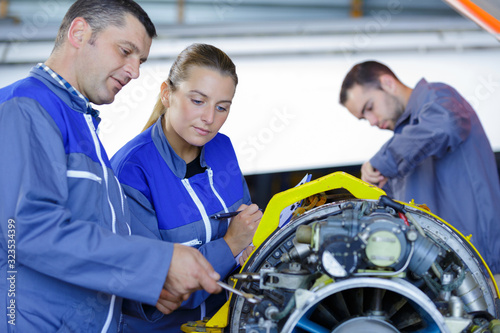 two engineers during aircraft future assembling Canvas Print