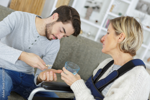 close-up of son giving ill person medicines Canvas Print