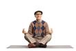 Elderly man sitting on a mat and meditating