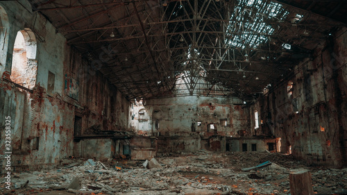 Inside ruined and abandoned large creepy industrial factory warehouse hangar, to Wallpaper Mural