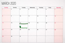 March 2020 Calendar With St. Patricks Day Written On Tuesday The 17th. Decorated With Green Hat And Green Clover Decoration. .Celebration And Anniversary Concept.