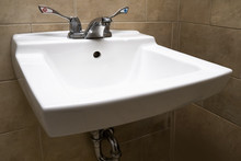 A White Bathroom Sink With Lar...
