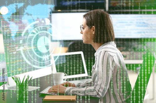 Fotografia Female programmer working in office