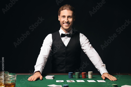 Fotografia Young male banker at table in casino