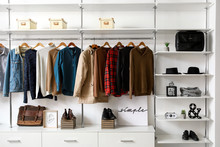 Modern Wardrobe With Stylish Winter Clothes And Accessories