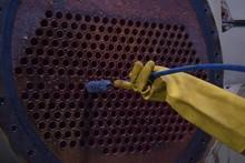 Soft Focus On Brush To Clean Condenser Tube Of Chiller - HVAC System