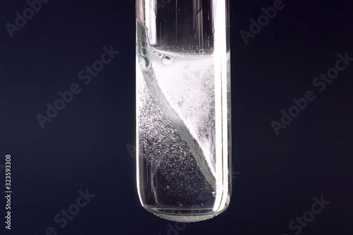 Photo Laboratory flask with a tungsten plate in alkali