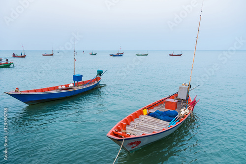 Floating fishing boats aground at the harbor over cloudy sky at Chanthaburi, Thailand Canvas Print