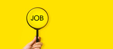 Job Search Concept, Inscription And Magnifier In Hand On A Yellow Background