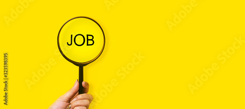 Obraz job search concept, inscription and magnifier in hand on a yellow background - fototapety do salonu