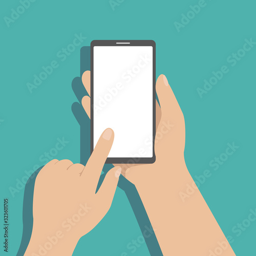 Foto Man hold smartphone in hand and tap on screen with finger