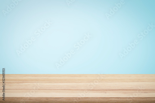 Fototapeta Empty wooden deck table over light blue wallpaper background for present product. obraz