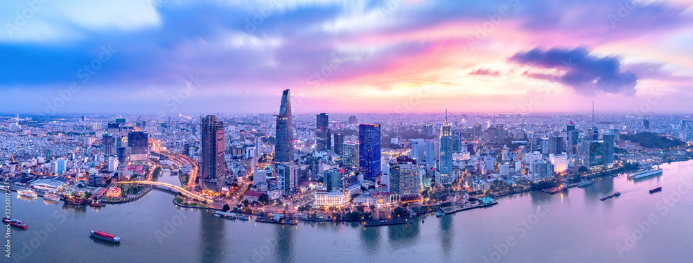 Fototapeta Top view aerial photo from flying drone of a Ho Chi Minh City with development buildings, transportation, energy power infrastructure. Financial and business centers in developed Vietnam.