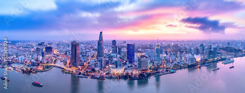 Top view aerial photo from flying drone of a Ho Chi Minh City with development buildings, transportation, energy power infrastructure. Financial and business centers in developed Vietnam.