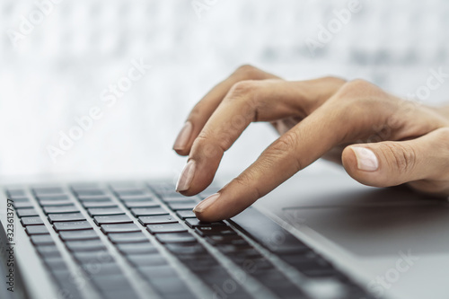 Fototapety, obrazy: Female finger presses a button on a laptop keyboard, business and technology concept. Close up
