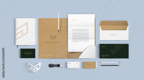 Fototapeta Stationery mockup vector set. Corporate identity premium branding design. Template for business and respectable company. Folder and A4 letter, visiting card and envelope based on minimal brown logo. obraz