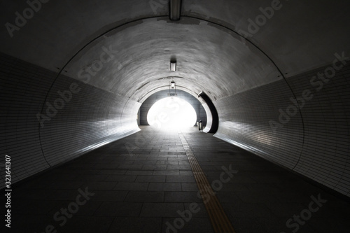 Exit from the empty round concrete tunnel outside, with light in the end Canvas