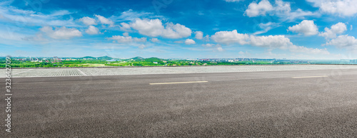 Fotografiet Wide asphalt highway and city suburb skyline on a sunny day in Shanghai,panoramic view