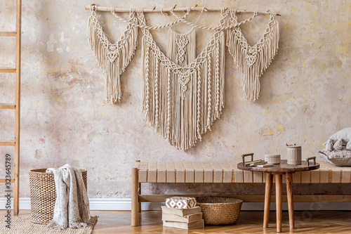 Papel de parede Interior design of stylish living room with beige chaise longue, beautiful macrame, rattan basket, ladder, books, tea pot on the tray and elegant personal accessories