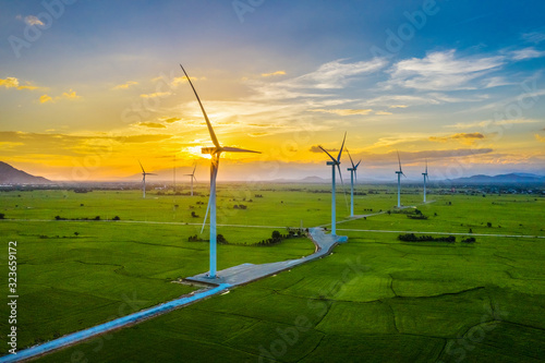 Obraz Landscape with Turbine Green Energy Electricity, Windmill for electric power production, Wind turbines generating electricity on rice field at Phan Rang, Ninh Thuan, Vietnam. Clean energy concept. - fototapety do salonu