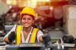 Leinwandbild Motiv Girl teen worker with safety helmet happy smiling working labor in industry factory with steel machine.