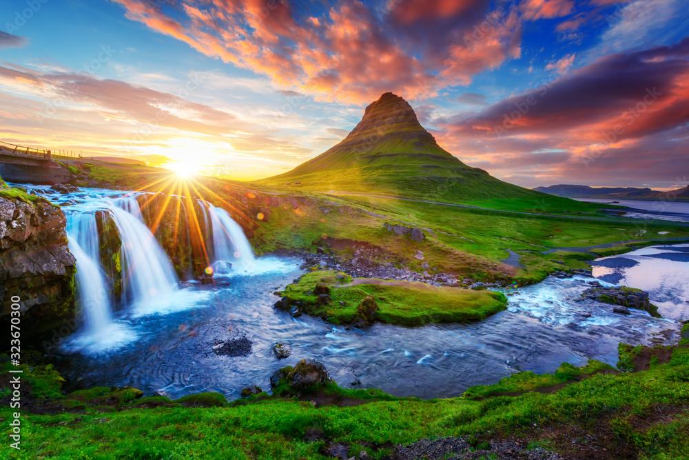 Fototapeta Gorgeous landscape with rising sun on Kirkjufellsfoss waterfall and Kirkjufell mountain, Iceland, Europe.