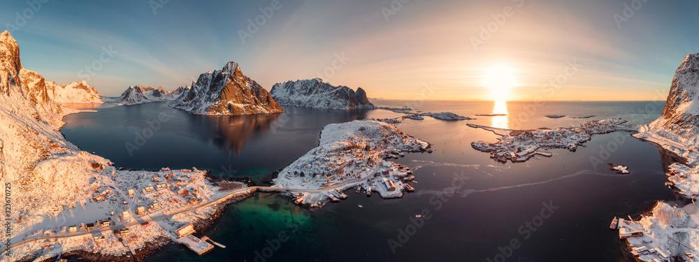 Fototapeta Sunrise on Lofoten island is archipelago with fishing village on coastline in winter at Norway