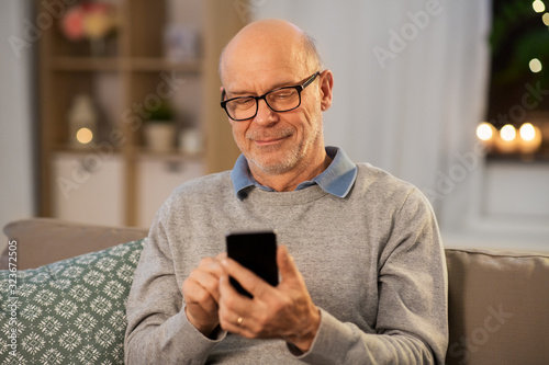 technology, people and communication concept - happy smiling bald senior man tex Fototapete