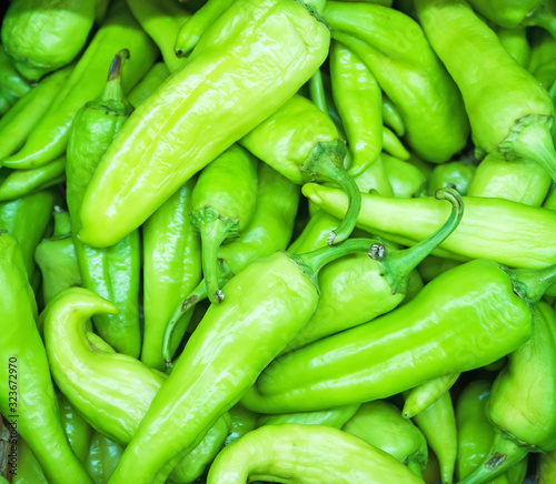 Close-up view of organic green peppers in supermarket.
