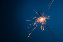 Burning Sparkler Bengal Fire On Blue Background