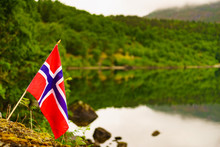Norwegian Flag On Green Nature