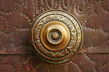 Golden Knob On Wooden Door