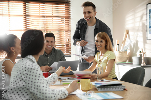Team of professional designers working in office