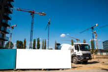 Blank White Banner For Advertisement On A Fence Of A Construction Site